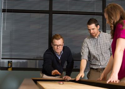The WIN employee lounge features table shuffleboard